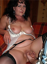 This hot dark haired MILF has hairy beaver and huge tits