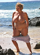 Hot gallery of amazing tanned MILFs with giant twins